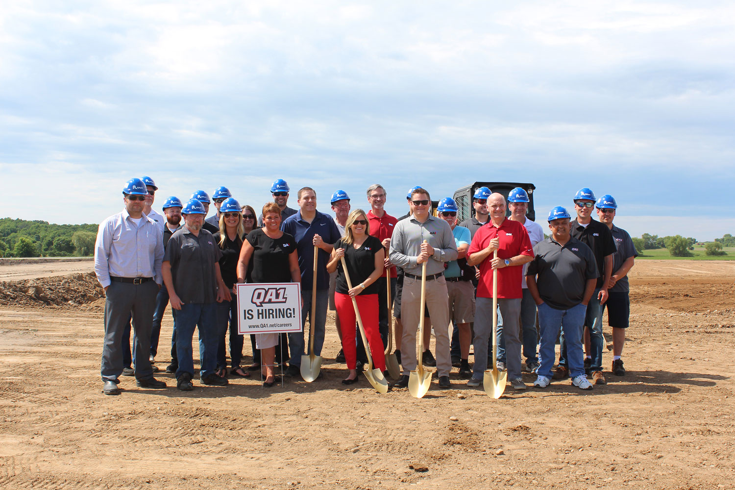 A group of QA1 employees gathers to break ground on the new modern facility